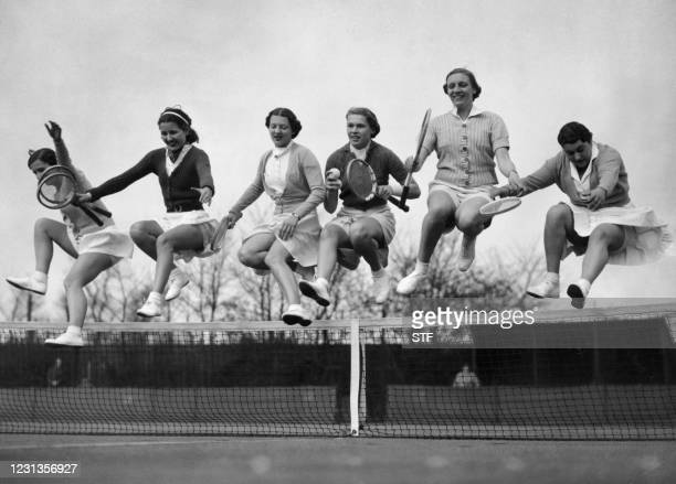 Picture taken 21 March 1938 on a tennis court in England of women preparing the tennis tournaments'season with gymnastic exercises.