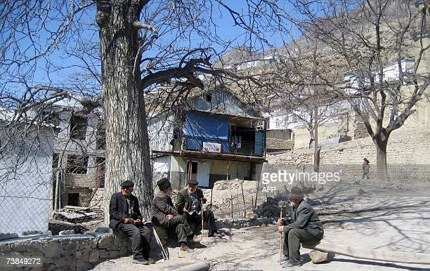 Picture taken 21 March 2007 shows men sitting in the village of Ghimri One of Russia's fiercest enemies Dagestani resistance leader Imam Shamil...