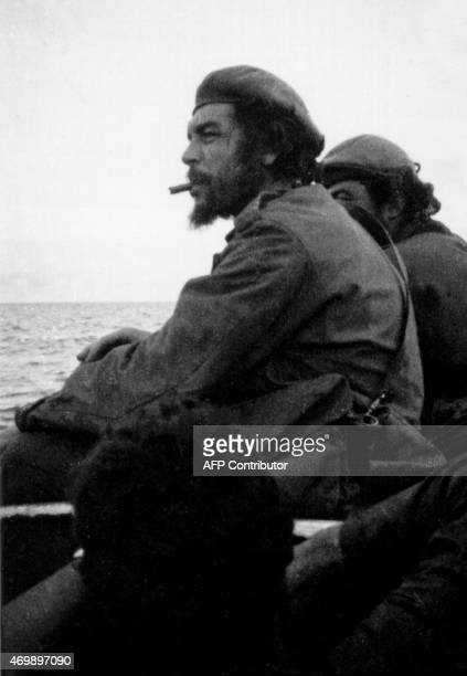 A picture taken 21 November 1965 of Argentineborn guerrilla leader Ernesto Che Guevara on board a barge while crossing the Tanganika Lake from the...