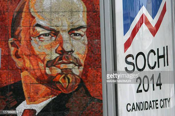 Picture taken 23 February 2007 showing an advertising poster in front of a mosaic of Vladimir Lenin founder of the Soviet State in the Black sea...
