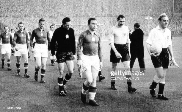 Picture taken 25 November 1953 showing Ferenc Puskas leading his team at Wembley Stadium of London prior to a friendly match against England. -...