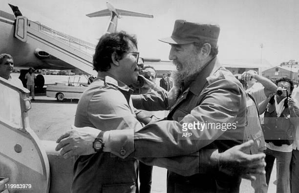 Picture taken 27 June 1988 of Cuban President Fidel Castro and Nicaraguan President Daniel Ortega during Ortega's arrival at Jose Marti International...