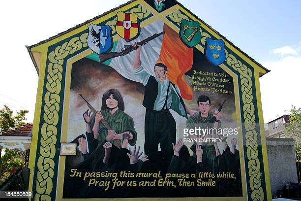 Picture taken 27 September 2005 of a memorial depecting the struggles during the IRA armed operations in Northern Ireland painted in the nationalist...