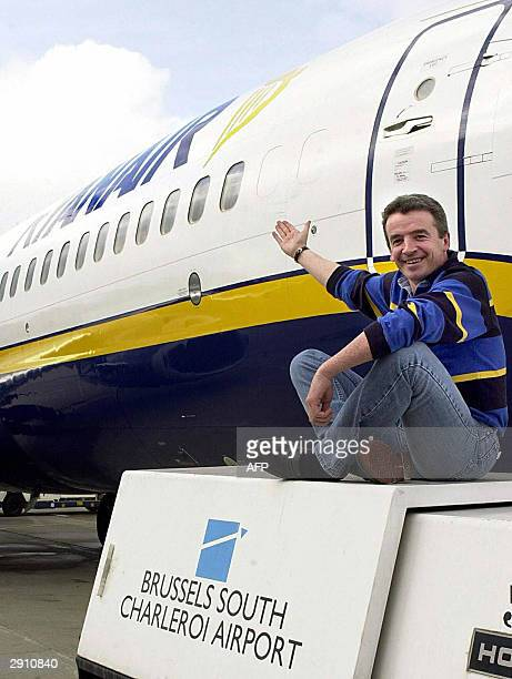 A picture taken 28 February 2001 shows Michael O'Leary chief executive of Irish Ryanair airlines near a Ryanair plane at the Gosselies airport in...