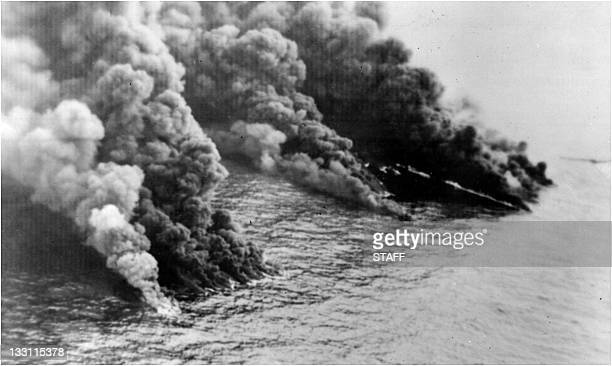 Picture taken 29 March 1967 of the burning Torrey Canyon' s remains after a decision was made to bomb the tanker During three days more than 1160...