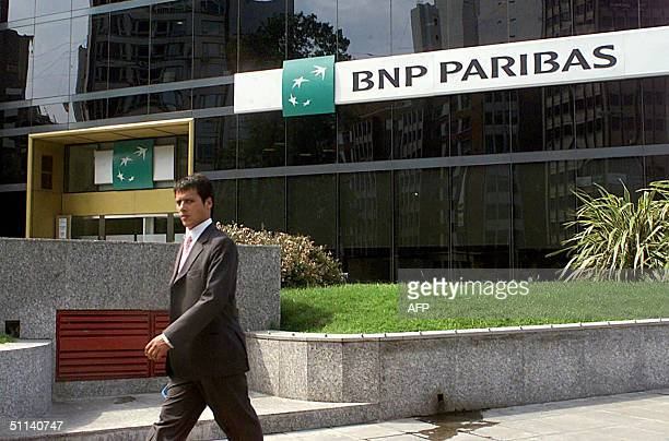 Picture taken 30 January 2002 shows a man walking past the BNP Paribas in Buenos Aires The Eurozone's biggest bank said 04 August 2004 it was in...