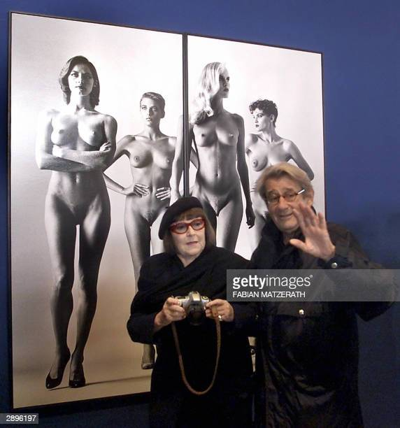 FILES Picture taken 30 October 2000 in Berlin shows German photographer Helmut Newton and his wife Jude posing in front of one of his pictures dated...
