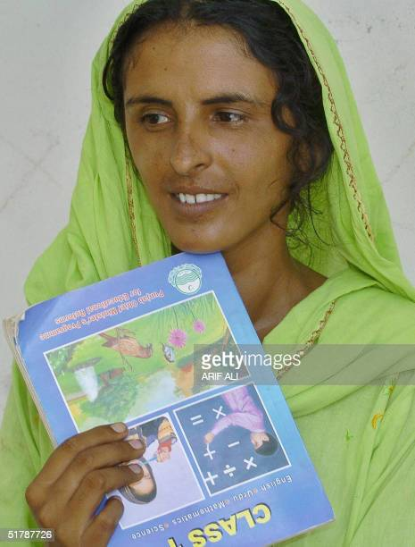 Picture taken 31 August 2004 shows Mukhtar Mai holding a book in Mirwala 460 kilometers south of Islamabad Women in Pakistan are subjected to brutal...