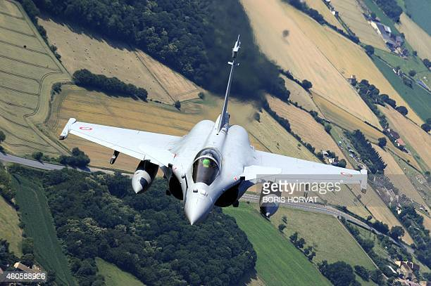 A picture taken aboard a boeing C135 supplying plane on June 29 2010 over Chateaudun western France shows a Rafale fighter jet performing during a...