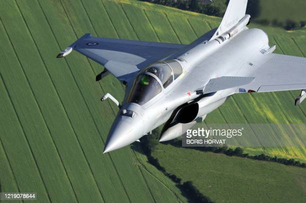 A picture taken aboard a supplying plane on June 29 2010 over Chateaudun western France shows a Rafale fighter jet performing during a training...
