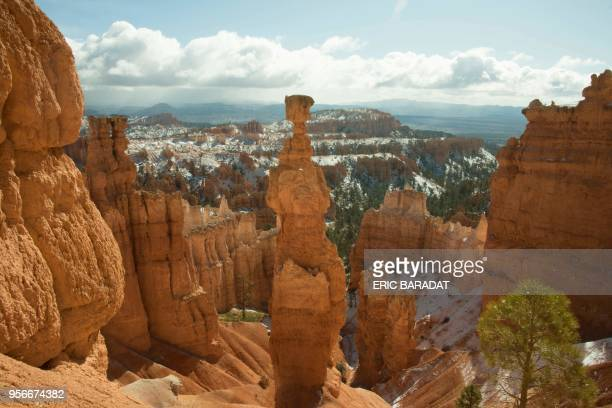 Picture taken after a light snowfall of Bryce Canyon National park in Utah on April 16, 2018. - Bryce Canyon National Park, a sprawling reserve in...