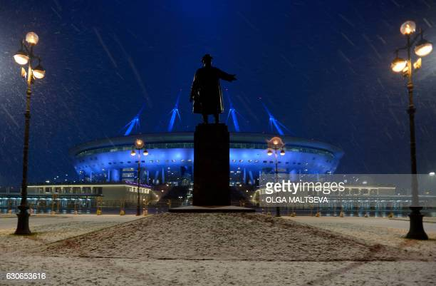 A picture taken as snow falls on December 29 2016 shows a monument to Soviet Unionera political leader Sergei Kirov outside Krestovsky football...