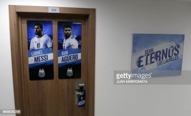A picture taken at Argentina's base camp in Bronnitsy south of Moscow on June 8 2018 shows the door of Argentina's football players Lionel Messi and...