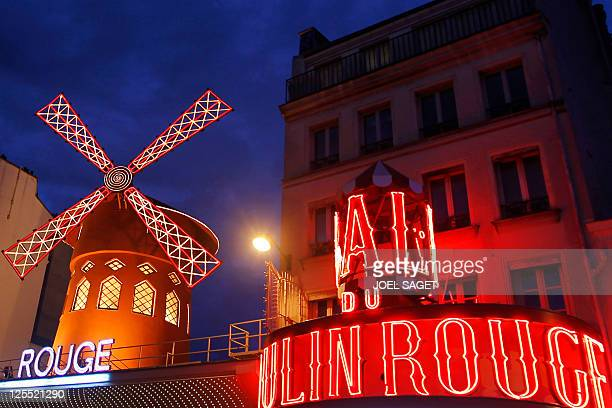 A picture taken at night on October 31 2010 in Paris shows the Moulin Rouge Cabaret AFP PHOTO / JOEL SAGET