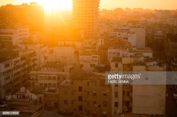 A picture taken at sunset on February 15 2016 shows the rooftops of old buldings in central Casablanca where poor locals have built shanty homes...