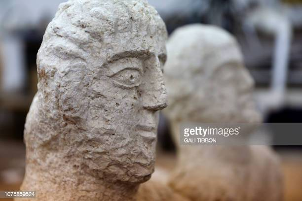 A picture taken at the Israel Antiquities Authority laboratories in Jerusalem on December 30 shows limestone busts that the IAA dated to the late...