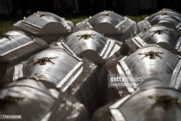 TOPSHOT A picture taken at the Nyanza Genocide Memorial suburb of the capital Kigali on May 4 2019 shows some of the 81 coffins containing newly...