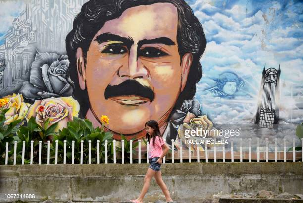 Picture taken at the Pablo Escobar neighbourhood in Medellin, Colombia, on November 28, 2018. - December 2, 2018 marks the 25th anniversary of...
