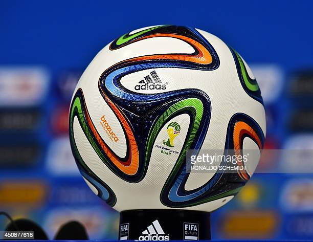 A picture taken at the Pernambuco Arena Stadium in Recife on June 19 2014 shows the Brazuca official ball during a press conference of Costa Rica on...