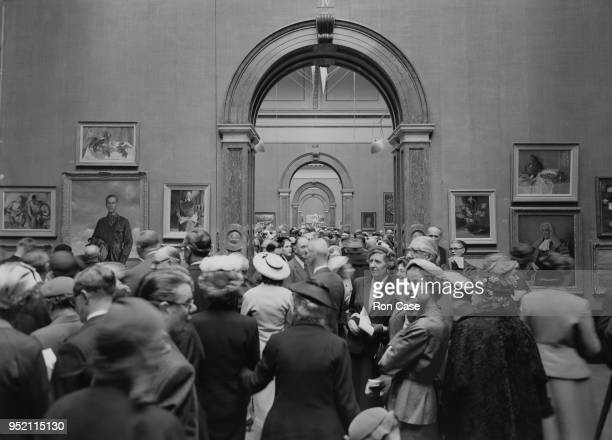 A picture taken at the Royal Academy on the first day on which photography was allowed inside the building Piccadilly London 4th May 1956 Visitors...