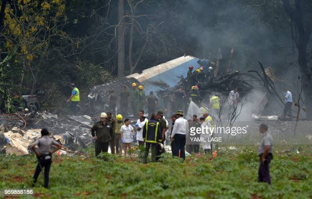 Picture taken at the scene of the accident after a Cubana de Aviacion aircraft crashed after taking off from Havana's Jose Marti airport on May 18...
