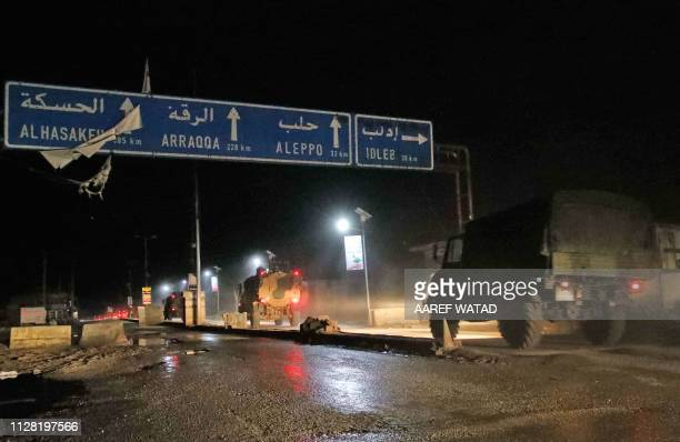 A picture taken before daybreak on March 1 2019 shows Turkish military vehicles heading towards the Syrian southern countryside of the rebelheld...