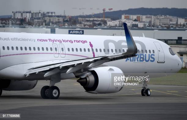 A picture taken behind a window shows The Airbus A321 LR neo test plane moving on the tarmac prior to take off from Le Bourget airport near Paris for...