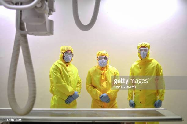 Picture taken by a doctor at the Sheikh Zayed hospital in the Egyptian capital Cairo on April 25 shows radiology technicians, wearing protective...