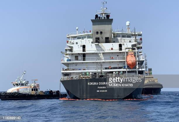 A picture taken during a guided tour by the US Navy shows the damage of Japanese oil tanker Kokuka Courageous off the port of the Gulf emirate of...