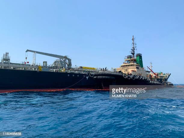 A picture taken during a guided tour by the US Navy shows the Japanese oil tanker Kokuka Courageous off the port of the Gulf emirate of Fujairah on...