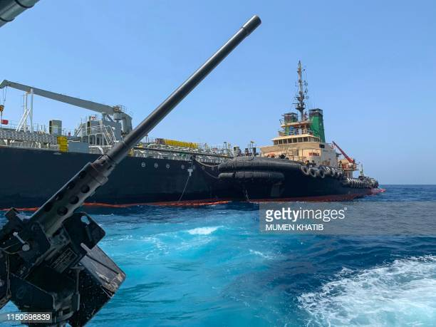 Picture taken during a guided tour by the US Navy shows the Japanese oil tanker Kokuka Courageous off the port of the Gulf emirate of Fujairah on...