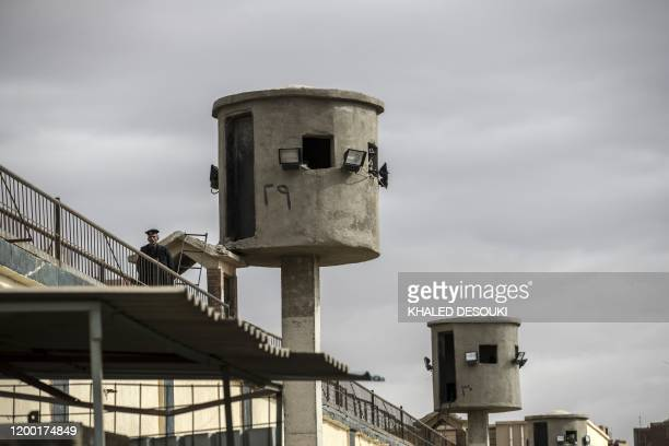 Picture taken during a guided tour organised by Egypt's State Information Service on February 11 shows an Egyptian policeman near watch towers at...