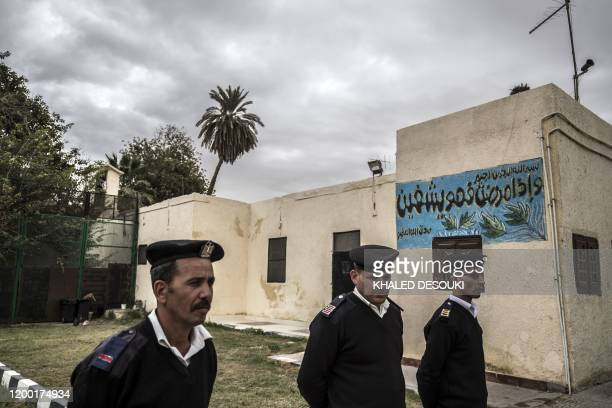 Picture taken during a guided tour organised by Egypt's State Information Service on February 11 shows policmen standing guard in front of the Tora...