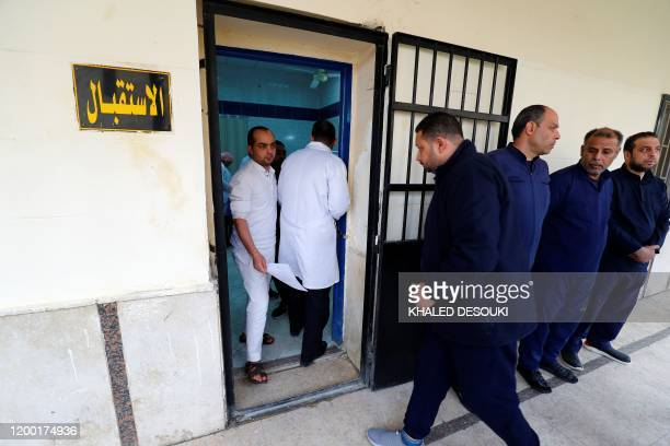 A picture taken during a guided tour organised by Egypt's State Information Service on February 11 shows detainees waiting their turn to receive...