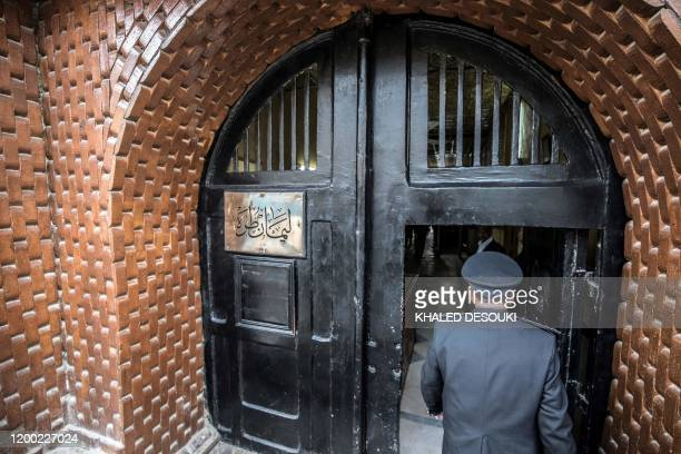 A picture taken during a guided tour organised by Egypt's State Information Service on February 11 shows an Egyptian police officer entering the Tora...