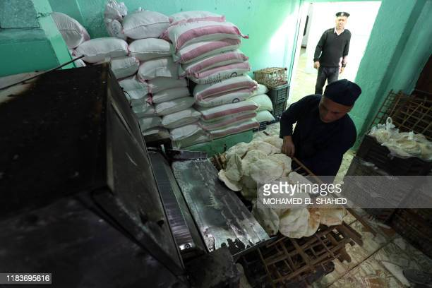 TOPSHOT A picture taken during a guided tour organised by the Egyptian State Information Service on November 20 shows an inmate preparing bread at...