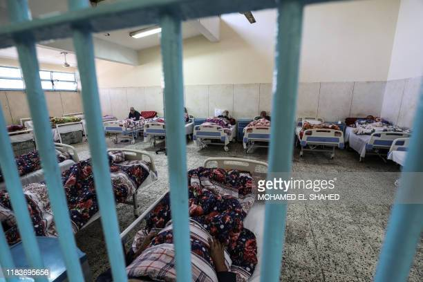 A picture taken during a guided tour organised by the Egyptian State Information Service on November 20 shows inmates receiving medical treatment at...
