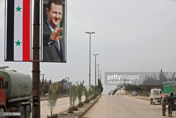 Picture taken during a guided tour organised by the Syrian Ministry of Information shows a poster of Syrian President Bashar al-Assad adorning the M5...