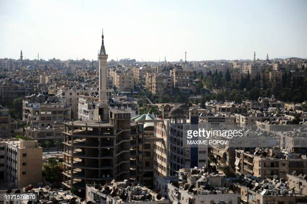 Picture taken during a guided tour with the Russian army shows damaged buildings in Aleppo on September 27, 2019.