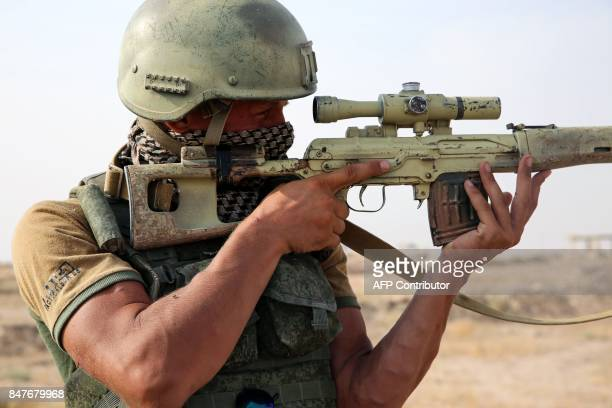 TOPSHOT A picture taken during a press tour provided by the Russian Armed Forces on September 15 2017 shows a Russian soldier looking through the...