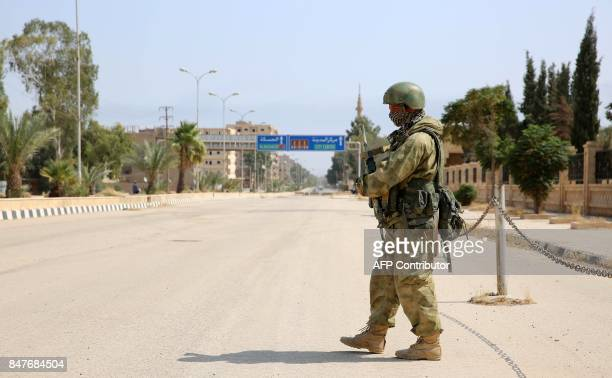 A picture taken during a press tour provided by the Russian Armed Forces on September 15 2017 shows a Russian soldier standing guard in a central...
