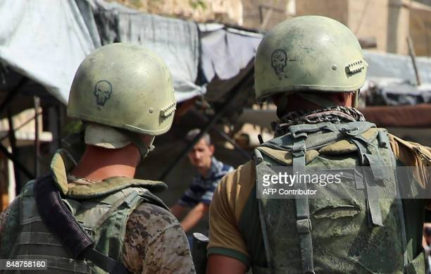 A picture taken during a press tour provided by the Russian Armed Forces on September 15 2017 shows Russian soldiers standing guard in a central...