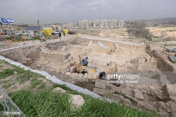 Picture taken during a press tour shows a team sifting through the archaeological site where the largest oil lamp workshops was unearthed in the...