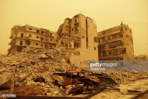 TOPSHOT A picture taken during a sandstorm shows destruction in the once rebel held Bab alNasr neighbourhood in Aleppo north on March 10 2017 / AFP...