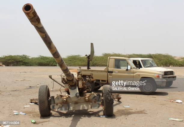 A picture taken during a tour organised by Yemeni loyalist fighters backed by Saudi and Emirati forces on June 2 2018 shows a Russianmade 130mm...