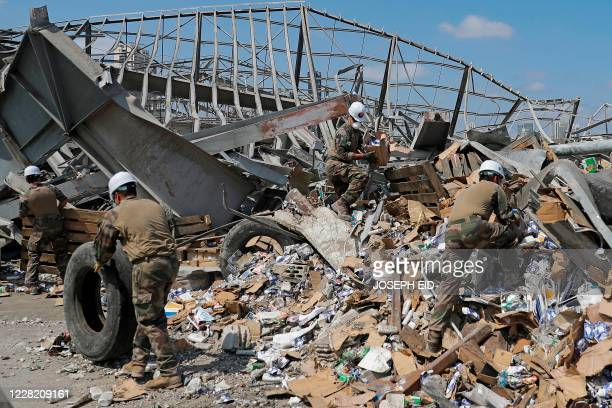 A picture taken during an organised media tour on August 26 2020 shows members of the French military clearing the rubble and debris in a joint...