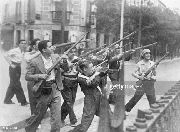 Picture taken during the Spanish Civil War in the late 30s of Republicans fighting in a street of an unidentified town against nationalist rebels