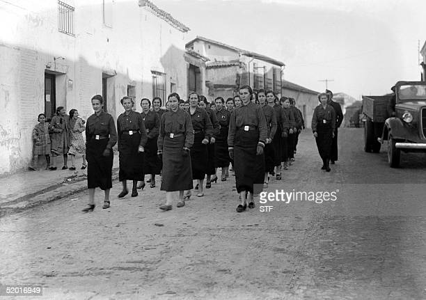 Picture taken during the Spanish Civil War in the late 30s of Nationalist women loyal to General Franco marching in an unidentified village of Spain...