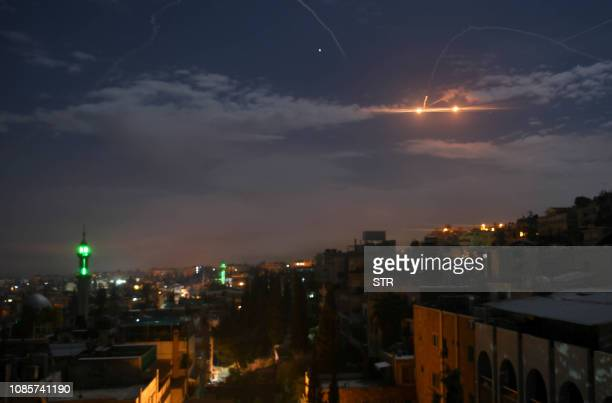 A picture taken early on January 21 2019 shows Syrian air defence batteries responding to what the Syrian state media said were Israeli missiles...