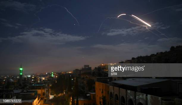 TOPSHOT A picture taken early on January 21 2019 shows Syrian air defence batteries responding to what the Syrian state media said were Israeli...